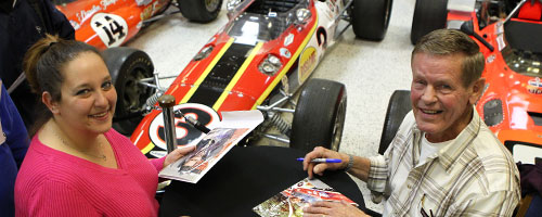 Bobby Unser signing autographs at IMS Museum