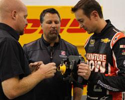 Kurt Busch looking over steering wheel