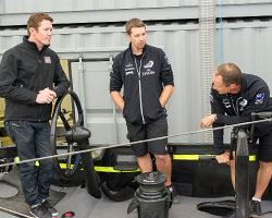 Scott Dixon with members of New Zealand's America's Cup team