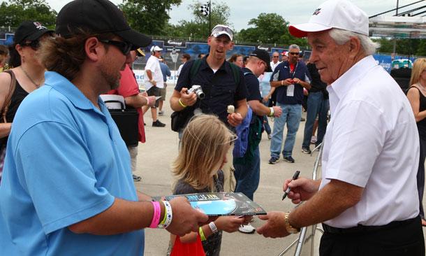 Roger Penske signs autographs