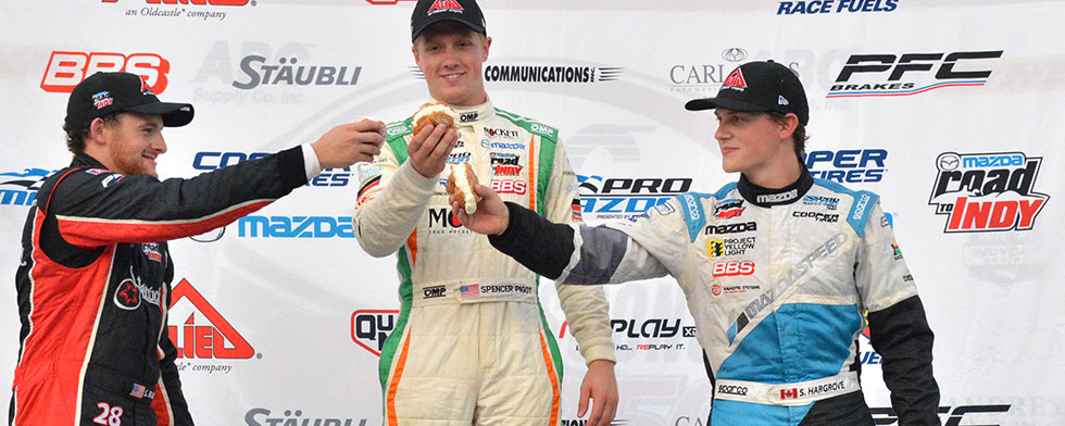 Pigot wins at Milwaukee, leads entering finale